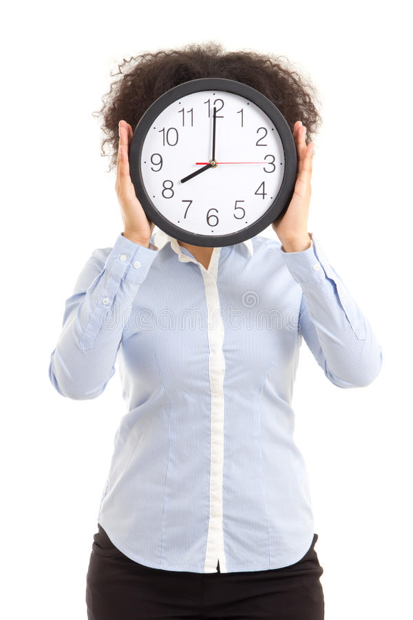 Woman covering face with office clock isolated on white. Background royalty free stock photo