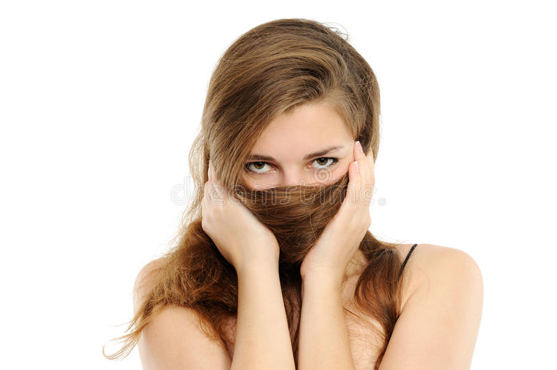 The woman covering with hair a nose and lips royalty free stock image