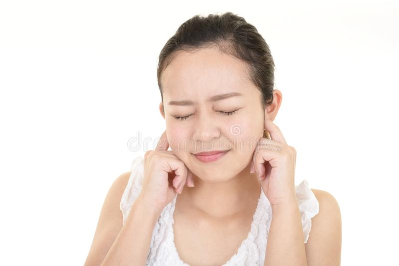 Woman closing ears. Woman covering her ears with closed eyes royalty free stock photos