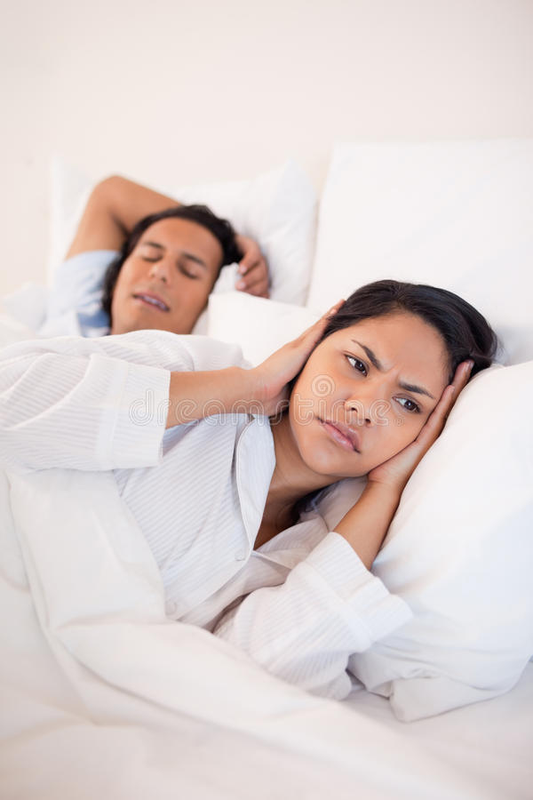 Download Woman Covering Her Ears To Block Her Boyfriends Snoring Stock Image - Image: 22345953