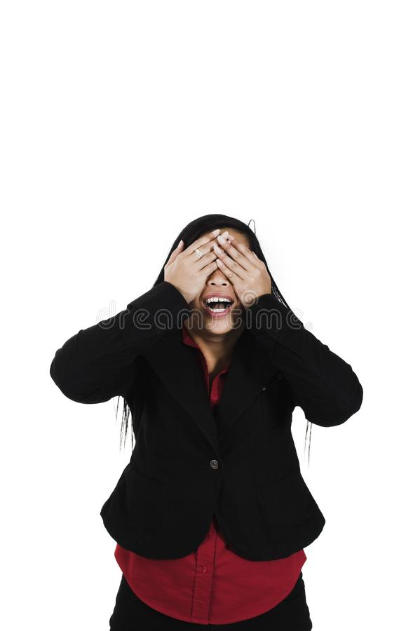 Woman covering her eyes stock photography