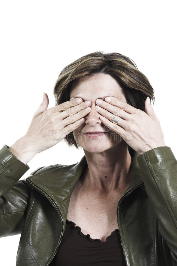 Download Woman Covering Her Eyes With Her Hands Stock Photo - Image: 1417788