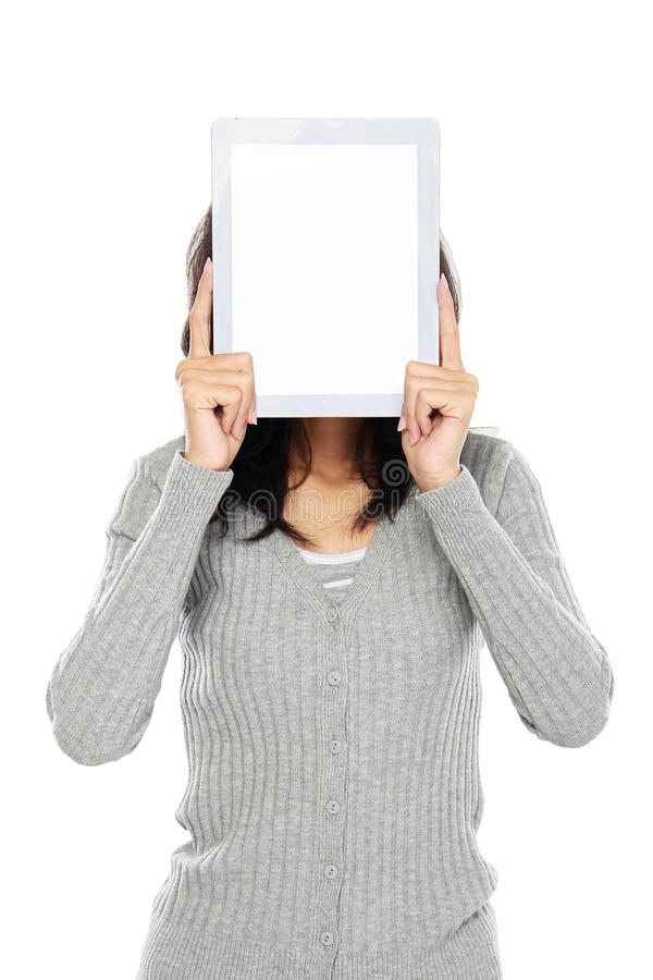 Woman covering her face with tablet computer stock images