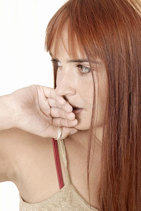 Woman covering her lips stock image
