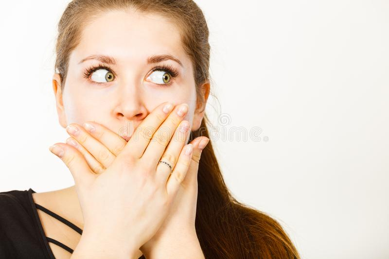 Woman covering her mouth with hand royalty free stock photos