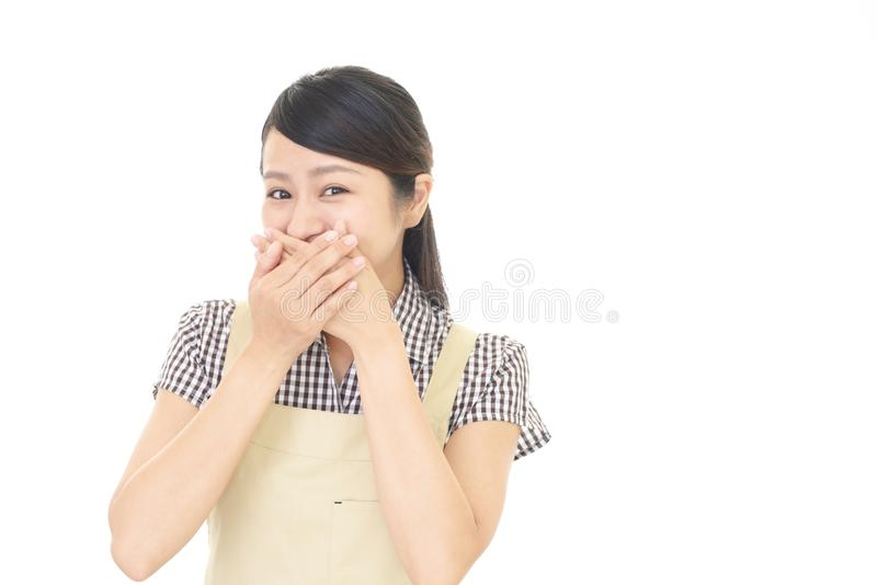 Woman covering her mouth. Portrait of an Asian housewife stock photos
