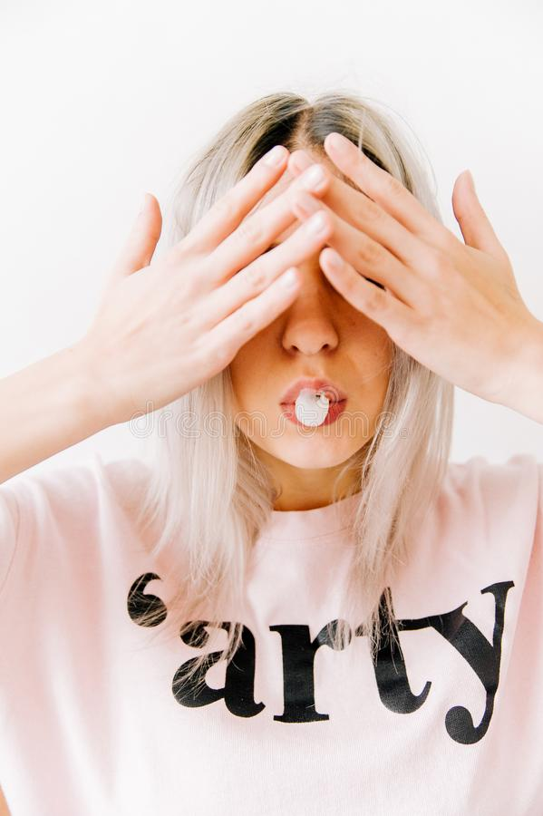 Woman Covering Her Two Eyes royalty free stock images