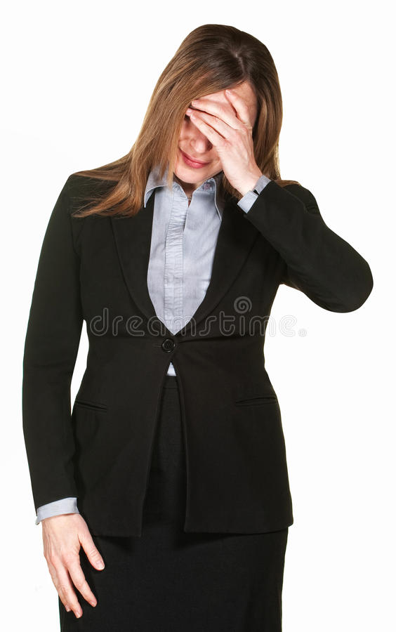 Woman Covers Face. Professional woman isolated on white with hand on face royalty free stock image