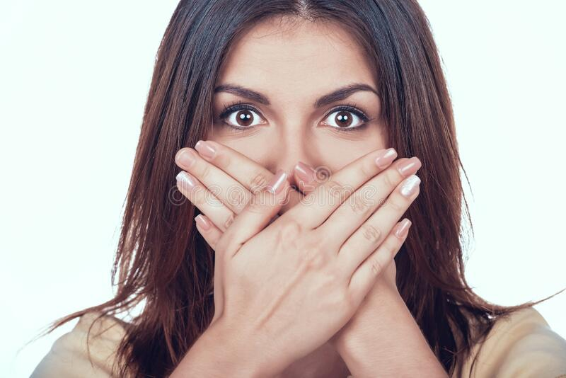 Woman Covers Mouth Social Pressure and Censorship. royalty free stock photos