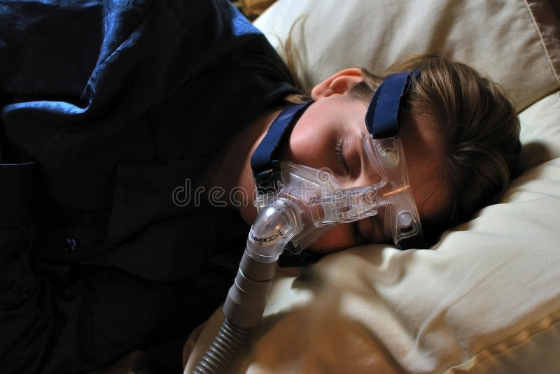Woman With CPAP Mask Royalty Free Stock Photos