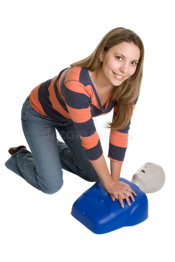 Woman CPR Training. Beautiful smiling woman cpr training stock photography