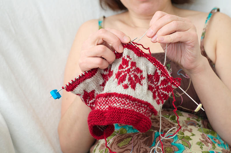 Woman craftwork knitting. Caucasian woman craftwork knitting with the needle stock image