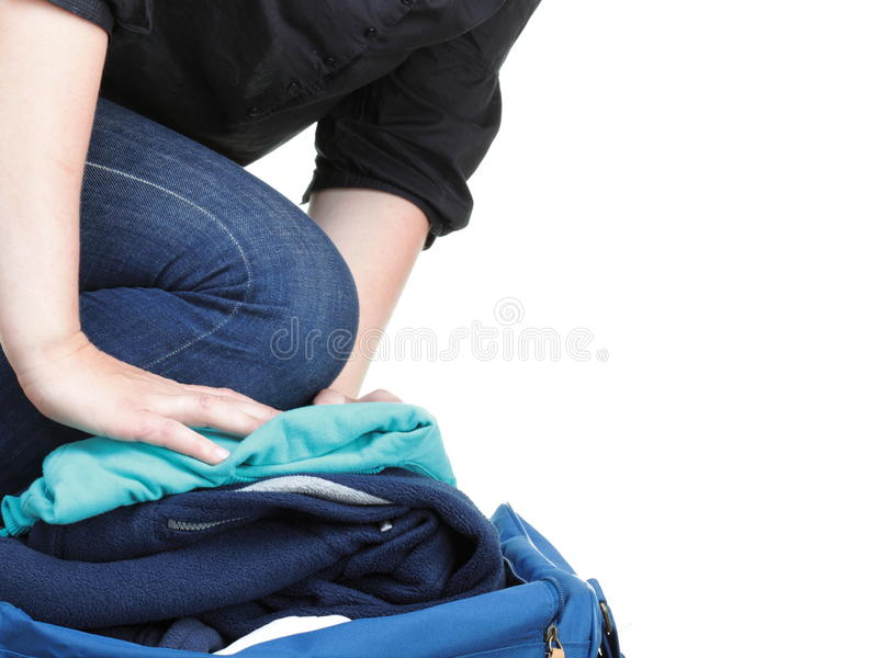 Woman Crammed Full Of Clothes And Shoulder Bag Isolated Stock Photo