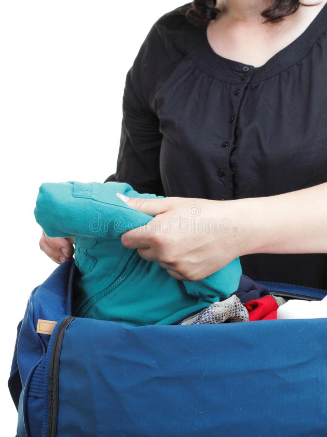 Woman Crammed Full Of Clothes And Shoulder Bag Isolated Stock Images