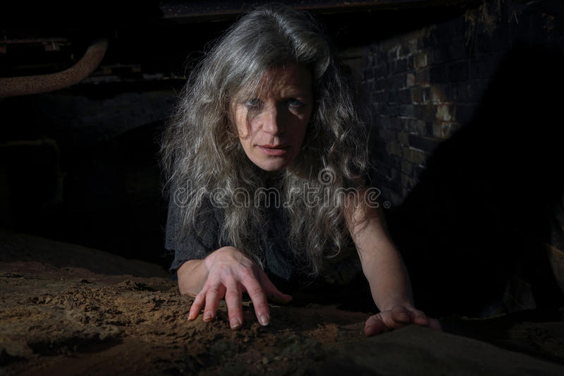 Woman crawling in Derelict Building stock images