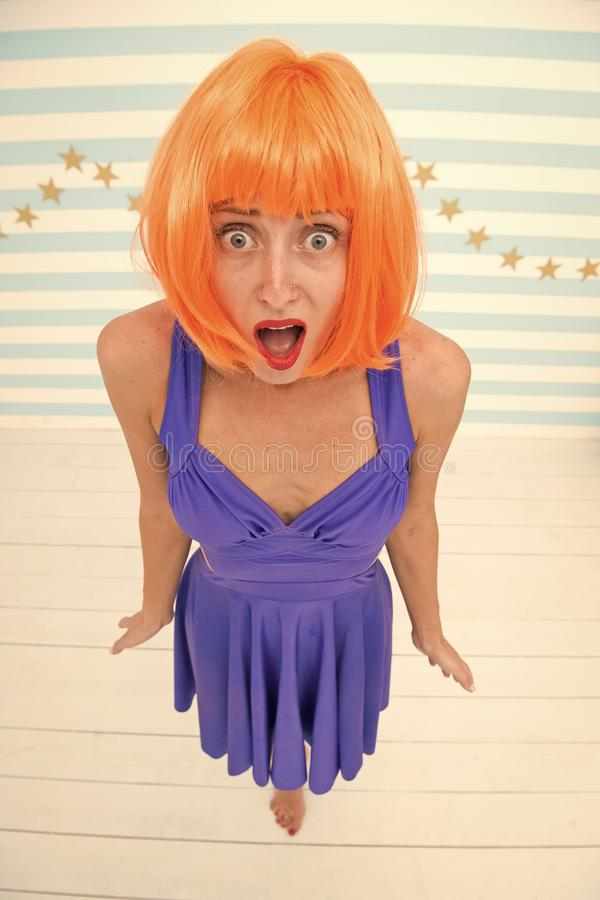Woman with crazy look. This is realy cool. i like it. pretty woman with orange hair. Woman with widely open mouth. Oops. I did it again. Oops, wow, but its royalty free stock photography
