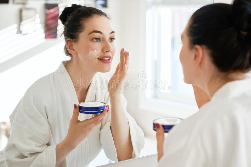 Woman with cream for her face royalty free stock photos