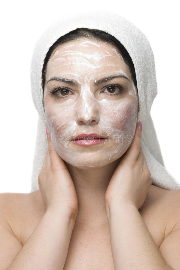 Woman with cream mask at daily spa stock photography