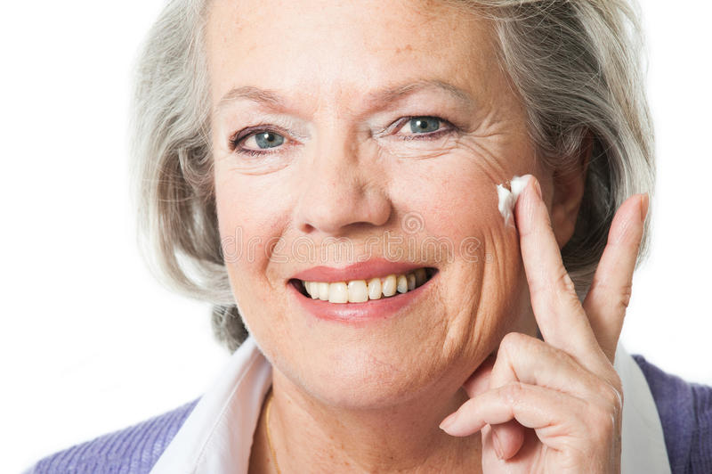 Woman with cream stock image