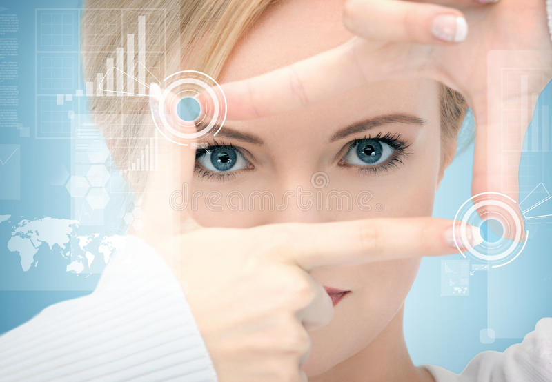 Woman creating frame with fingers stock photos