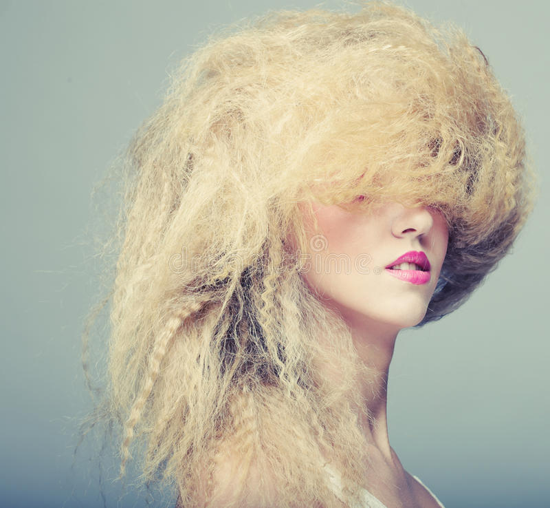 Woman with creative hairstyle. Young woman with creative hairstyle royalty free stock images