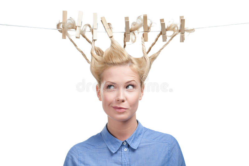 Woman with creative hairstyle of clothes pegs stock images