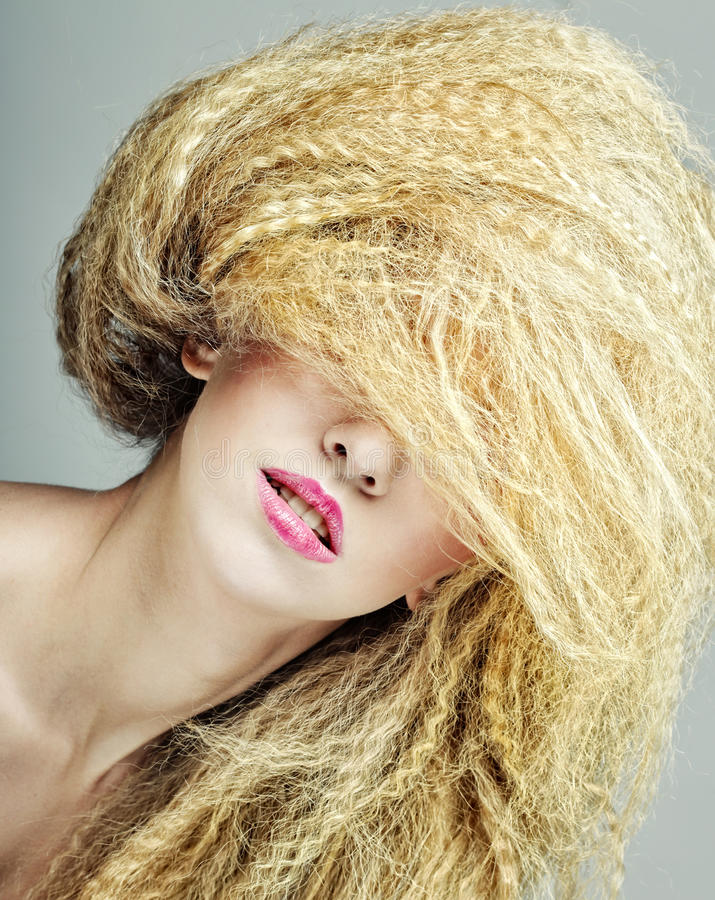 Woman with creative hairstyle. Young woman with creative hairstyle stock photos