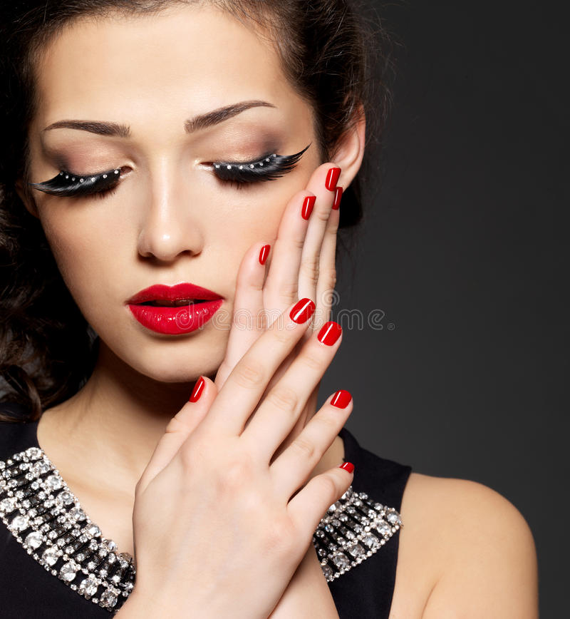 Woman with creative makeup using false eyelashes stock images