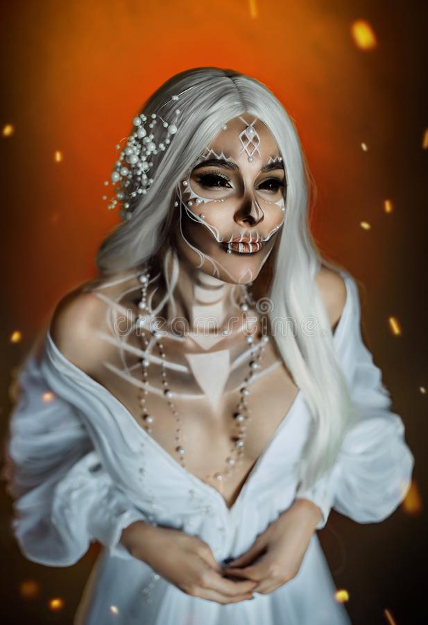 Woman with creative professional makeup Calavera Catrina. a gray-haired witch. Woman with creative professional makeup Calavera Catrina. The image of a gray royalty free stock image