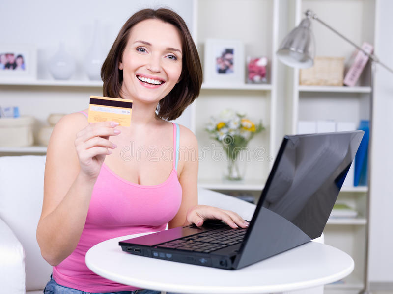 Download Woman with credit card stock photo. Image of home, portrait - 14057592