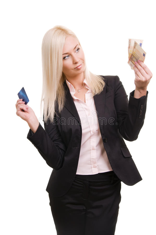 Woman with a credit card and cash in her hand stock image