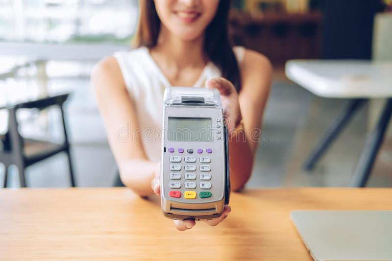 Woman with credit card swiping machine. shopping lifestyle & payment with nfc technology. Woman with credit card swiping machine. shopping lifestyle and payment royalty free stock image