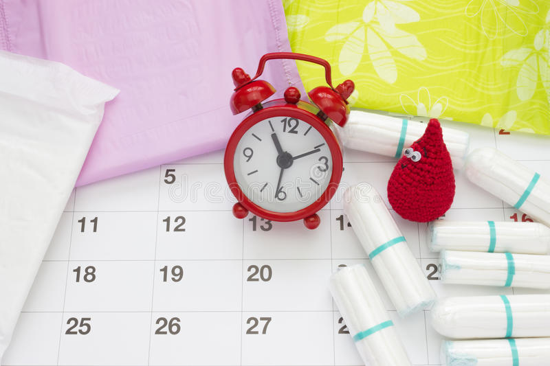 Woman critical days, gynecological menstruation cycle, blood period. Menstrual sanitary soft pads, tampons, calendar, red clocks w. Woman critical days royalty free stock photo