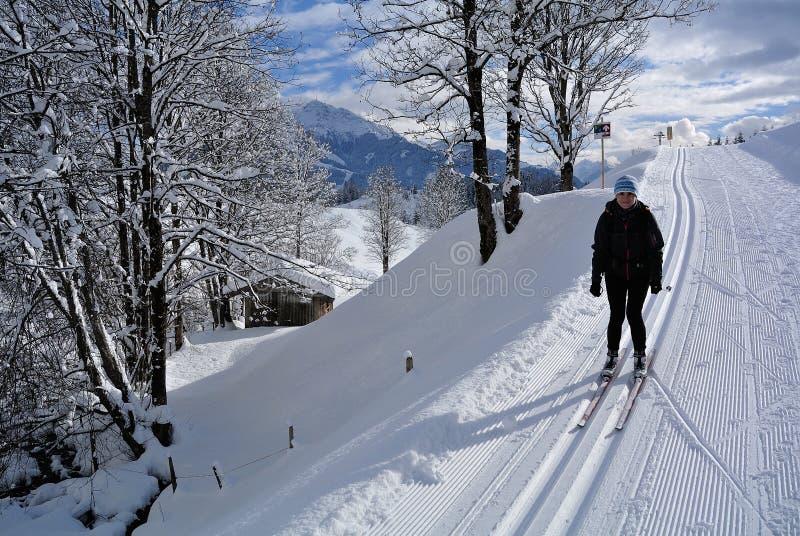 Nordic Skiing in Kaisergebirge, Tirol, Austria. Woman cross-country skiing in Kaisergebirge in Tirol - Austria stock photos