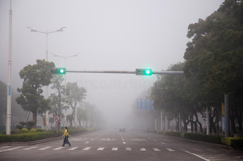 Download Woman crossing road in fog editorial stock photo. Image of light - 23535958
