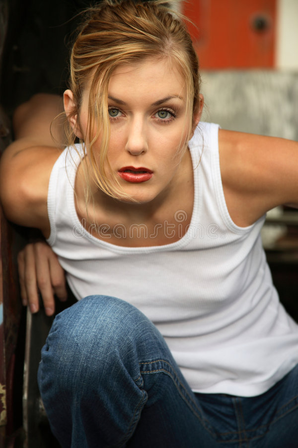 Free Woman Crouching Inside Truck Stock Images - 3794804