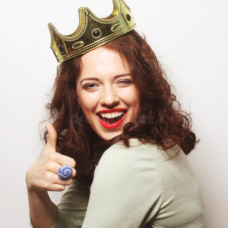 Woman in crown. Young lovely woman in crown royalty free stock images