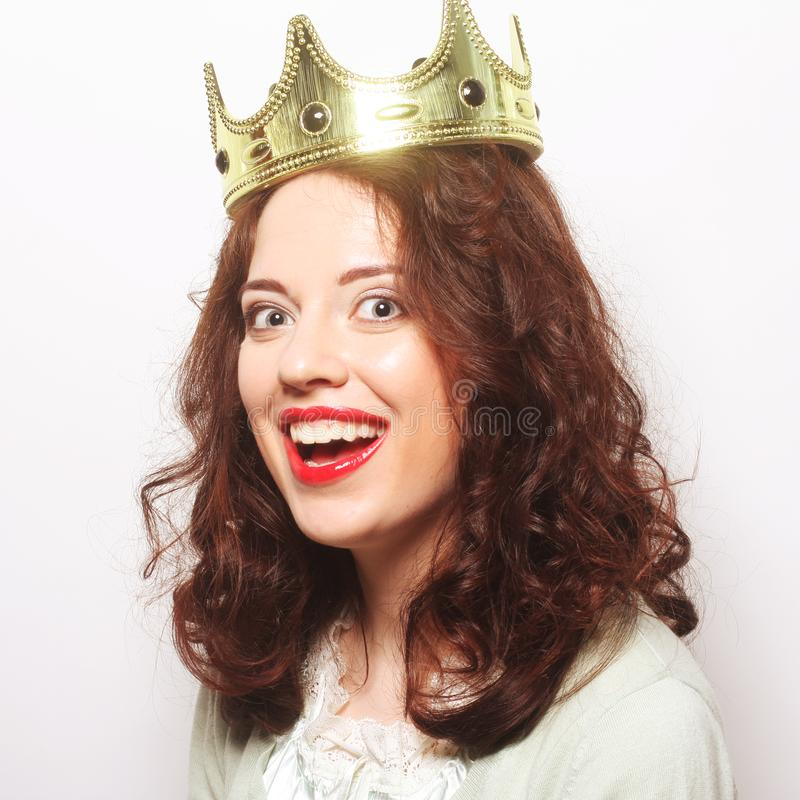 Woman in crown. Young lovely woman in crown royalty free stock photography