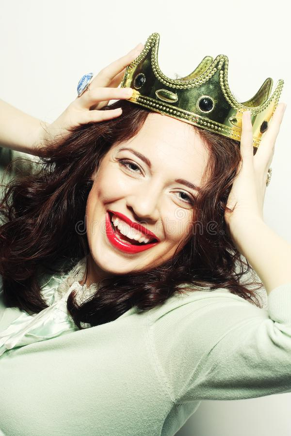 Woman in crown. Young lovely woman in crown stock image