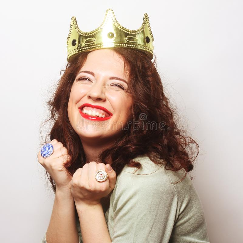 Woman in crown. Young lovely woman in crown royalty free stock photos
