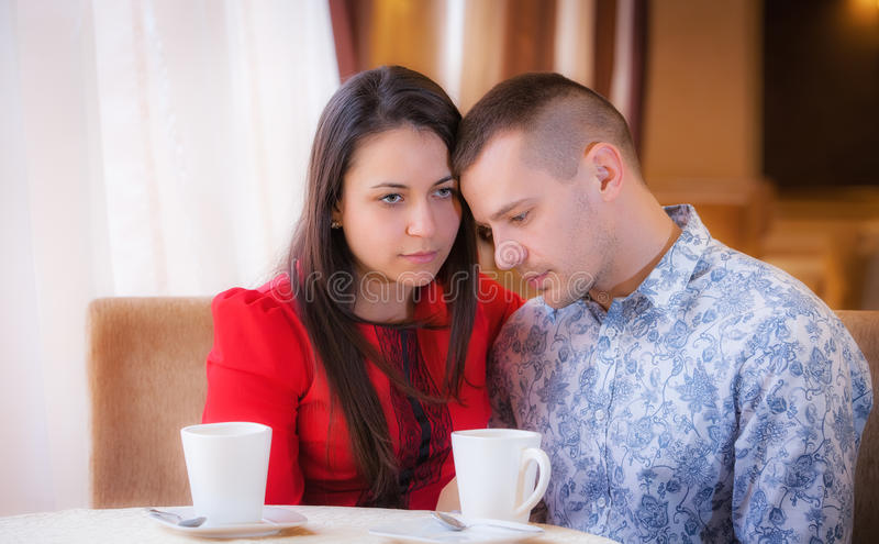 Woman crying in cafe. Relationship problems stock photos