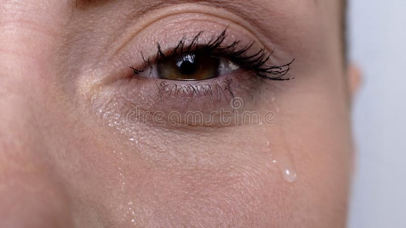 Woman crying suffering seasonal allergies, lacrimation, bad cosmetics quality. Stock photo royalty free stock photos