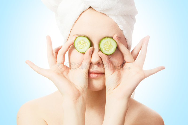 Woman With Cucumbers On Eyes Royalty Free Stock Photo
