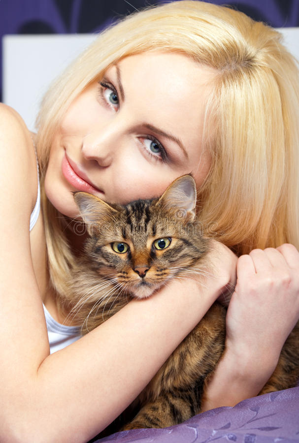 Free Woman Cuddling Cat Stock Photos - 14127783