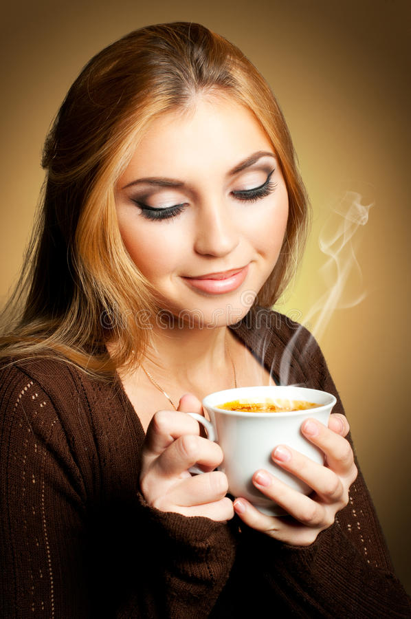 Woman with cup of Coffee. Beautiful girl holding a cup of hot coffee stock images