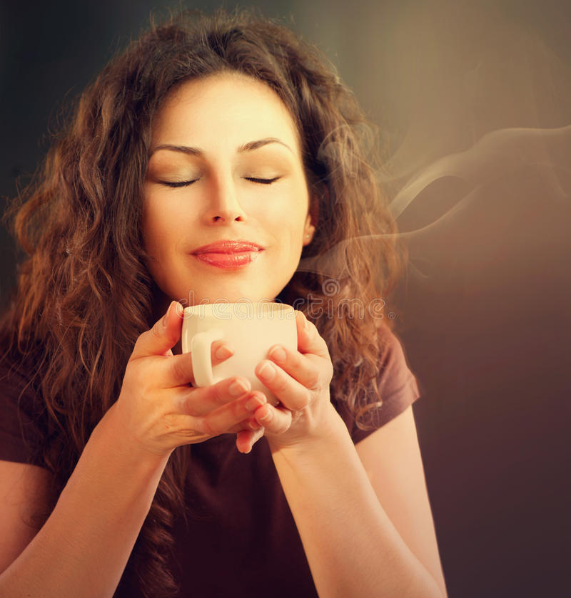 Woman With Cup of Coffee. Beauty Woman With Cup of Coffee or Tea