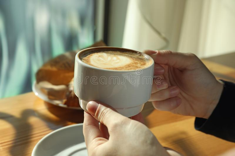 Woman with cup of fresh aromatic coffee at table royalty free stock images