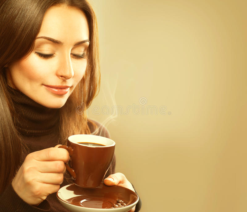 Woman with the Cup of Hot Coffee. Coffee. Beauty Model Woman with the Cup of Hot Drink royalty free stock photo