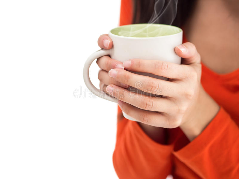 Woman with cup of hot coffee in hands stock images