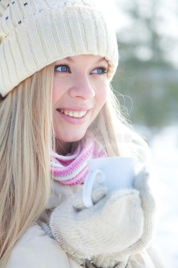 Woman with cup in winter royalty free stock photo